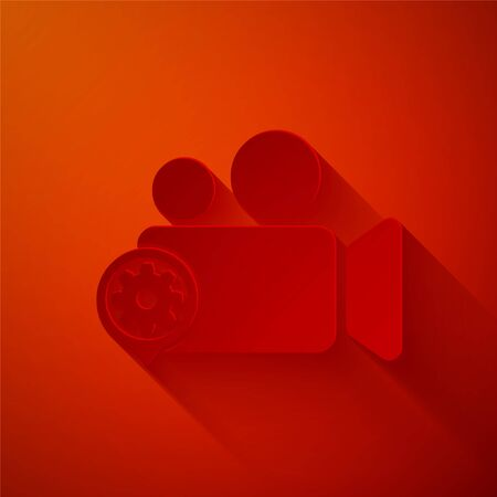 Paper cut Movie or Video camera and gear icon isolated on red background. Adjusting app, service concept, setting options, maintenance, repair, fixing. Paper art style. Vector Illustration