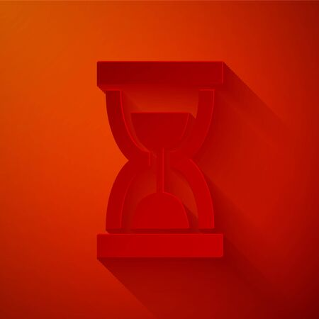 Paper cut Old hourglass with flowing sand icon isolated on red background. Sand clock sign. Business and time management concept. Paper art style. Vector Illustration