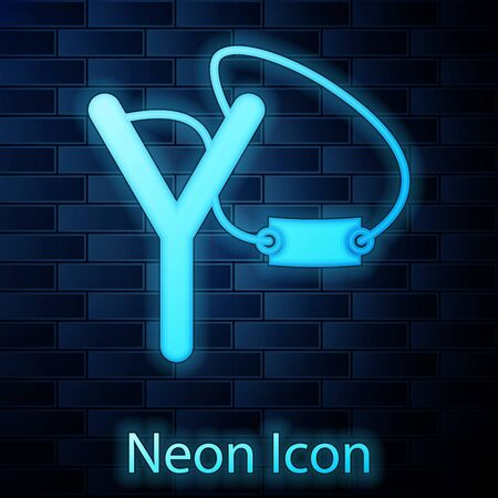 Glowing neon Slingshot icon isolated on brick wall background. Vector Illustration