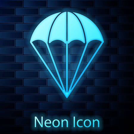 Glowing neon Parachute icon isolated on brick wall background. Vector Illustration