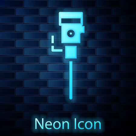 Glowing neon Construction jackhammer icon isolated on brick wall background. Vector Illustration