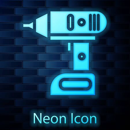Glowing neon Electric cordless screwdriver icon isolated on brick wall background. Electric drill machine. Repair tool. Vector Illustration