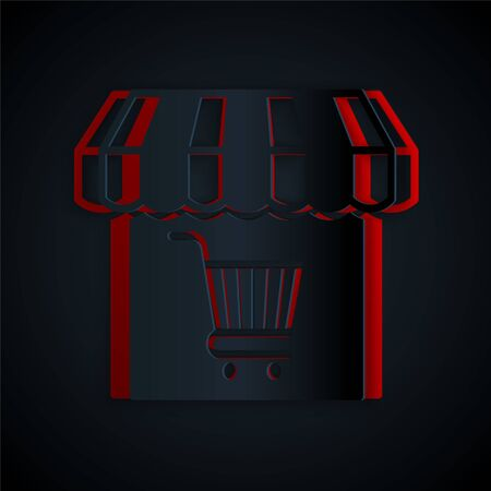 Paper cut Shopping building or market store with shopping cart icon isolated on black background. Shop construction. Supermarket basket symbol. Paper art style. Vector Illustration
