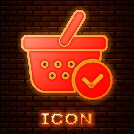 Glowing neon Shopping basket with check mark icon isolated on brick wall background. Supermarket basket with approved, confirm, tick, completed symbol. Vector Illustration Çizim