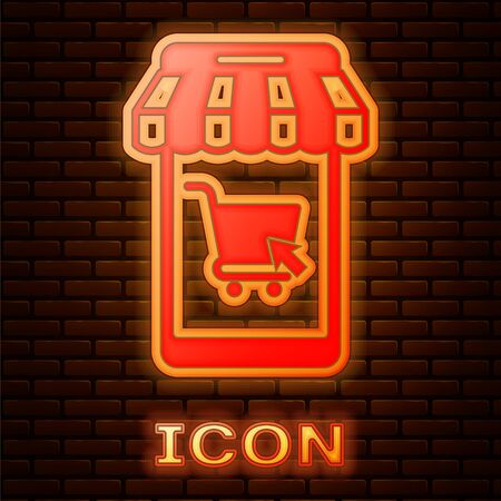 Glowing neon Mobile phone and shopping cart with striped awning icon isolated on brick wall background. Online buying symbol. Supermarket basket symbol. Vector Illustration
