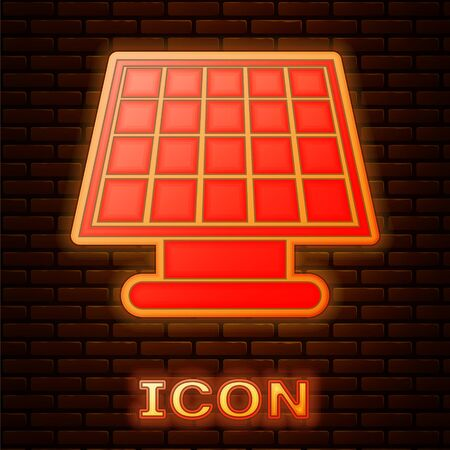Glowing neon Solar energy panel icon isolated on brick wall background. Vector Illustration