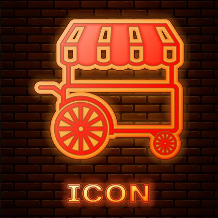 Glowing neon Fast street food cart with awning icon isolated on brick wall background. Urban kiosk. Vector Illustration