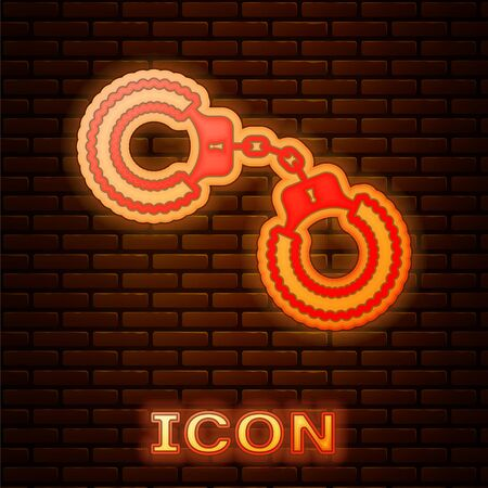 Glowing neon Sexy fluffy handcuffs icon isolated on brick wall background. Handcuffs with fur.