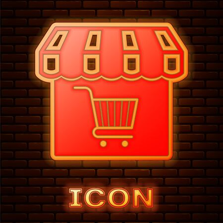 Glowing neon Shopping building or market store with shopping cart icon isolated on brick wall background. Shop construction. Supermarket basket symbol. Vector Illustration