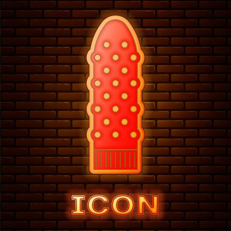 Glowing neon Dildo vibrator for sex games icon isolated on brick wall background. Sex toy for adult. Ilustrace