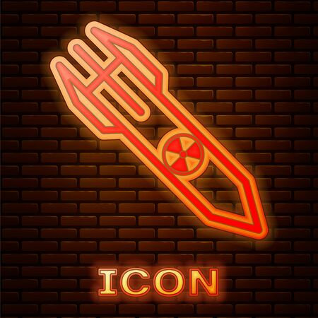 Glowing neon Nuclear rocket icon isolated on brick wall background. Rocket bomb flies down. Vector Illustration