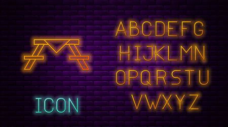 Glowing neon line Picnic table with benches on either side of the table icon isolated on brick wall background. Neon light alphabet. Vector Illustration