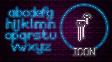 Glowing neon line Router and wifi signal symbol icon isolated on brick wall background.