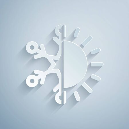 Paper cut Hot and cold symbol. Sun and snowflake icon isolated on grey background. Winter and summer symbol. Paper art style. Vector Illustration Vektoros illusztráció