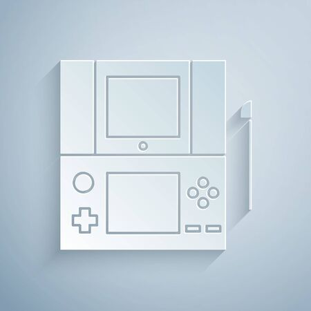Paper cut Portable video game console icon isolated on grey background. Gamepad sign. Gaming concept. Paper art style. Vector Illustration