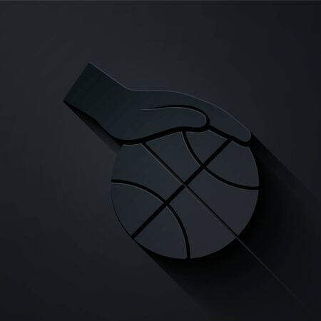 Paper cut Hand with basketball ball icon isolated on black background. Sport symbol. Paper art style. Vector Illustration