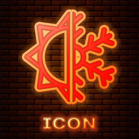 Glowing neon Hot and cold symbol. Sun and snowflake icon isolated on brick wall background. Winter and summer symbol. Vector Illustration Vektorové ilustrace