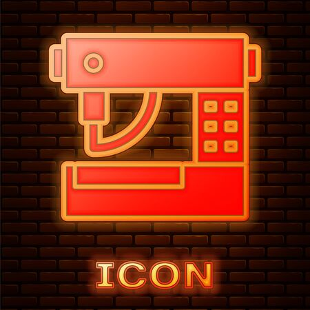 Glowing neon Sewing machine icon isolated on brick wall background. Vector Illustration