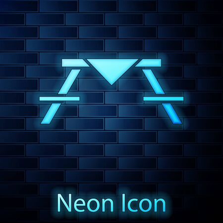 Glowing neon Picnic table with benches on either side of the table icon isolated on brick wall background.  Vector Illustration Stock Illustratie
