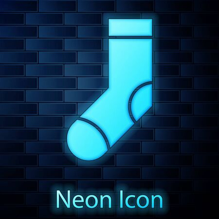 Glowing neon Socks icon isolated on brick wall background. Vector Illustration