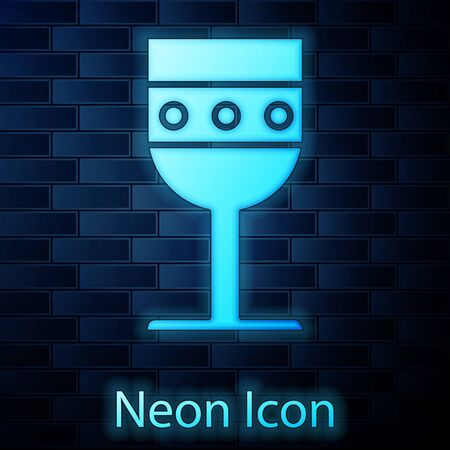 Glowing neon Medieval goblet icon isolated on brick wall background. Vector Illustration