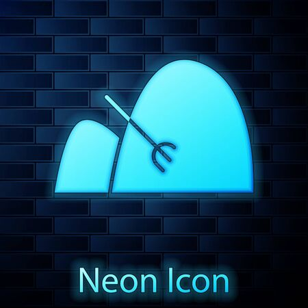Glowing neon Bale of hay and rake icon isolated on brick wall background. Vector Illustration Vettoriali