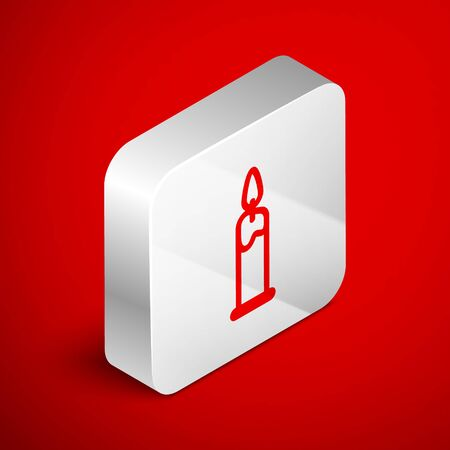 Isometric line Burning candle in candlestick icon isolated on red background. Cylindrical candle stick with burning flame. Silver square button. Vector Illustration