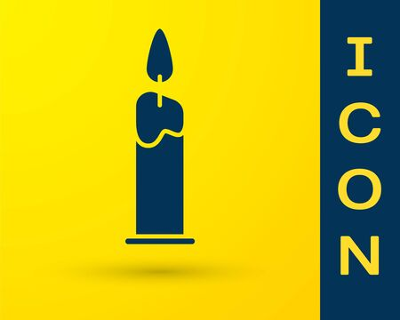 Blue Burning candle in candlestick icon isolated on yellow background. Cylindrical candle stick with burning flame. Vector Illustration