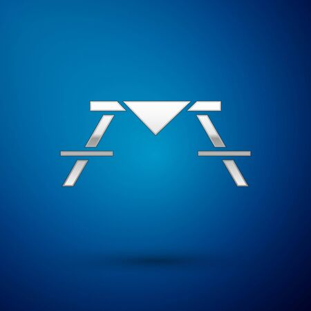 Silver Picnic table with benches on either side of the table icon isolated on blue background. Vector Illustration