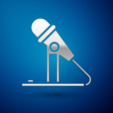 Silver Microphone icon isolated on blue background. On air radio mic microphone. Speaker sign. Vector Illustration