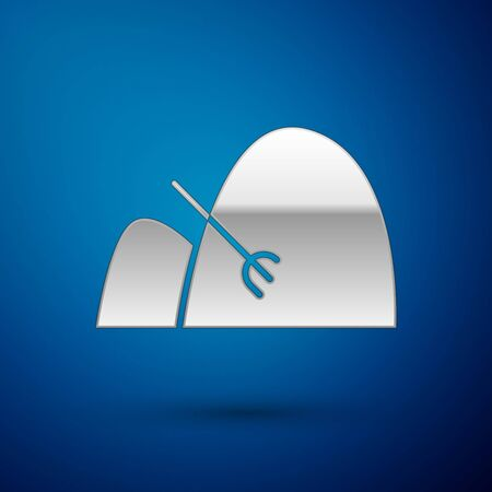 Silver Bale of hay and rake icon isolated on blue background. Vector Illustration