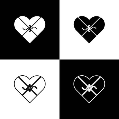 Set Candy in heart shaped box and bow icon isolated on black and white background. Valentines Day. Vector Illustration Foto de archivo - 138472379