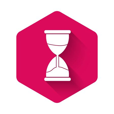 White Old hourglass with flowing sand icon isolated with long shadow. Sand clock sign. Business and time management concept. Pink hexagon button. Vector Illustration