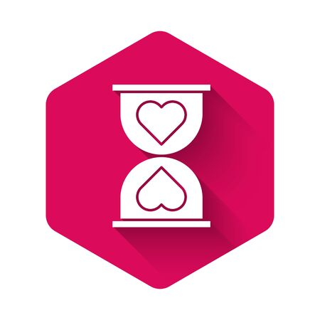 White Heart in the center old hourglass icon isolated with long shadow. Valentines day. Pink hexagon button. Vector Illustration