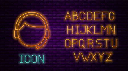 Glowing neon line Man with a headset icon isolated on brick wall background. Support operator in touch. Concept for call center, client support service. Neon light alphabet. Vector Illustration