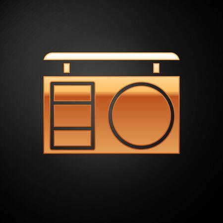 Paleta de sombras de ojos de oro con icono de pincel aislado sobre fondo negro. Ilustración vectorial