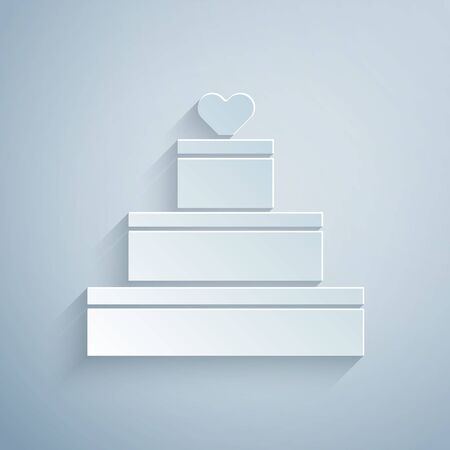 Paper cut Wedding cake with heart icon isolated on grey background. Valentines day symbol. Paper art style. Vector Illustration