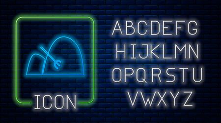 Glowing neon Bale of hay and rake icon isolated on brick wall background. Neon light alphabet. Vector Illustration