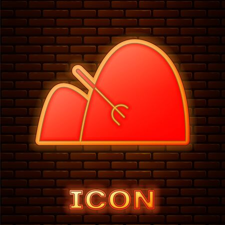 Glowing neon Bale of hay and rake icon isolated on brick wall background. Vector Illustration Ilustrace