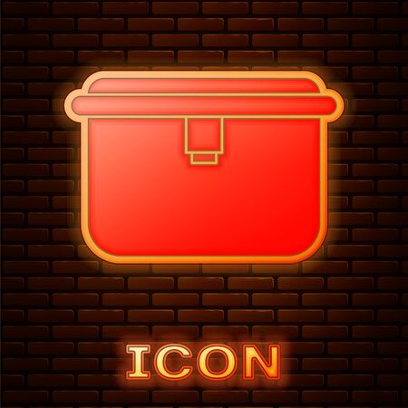 Glowing neon Lunch box icon isolated on brick wall background. Vector Illustration