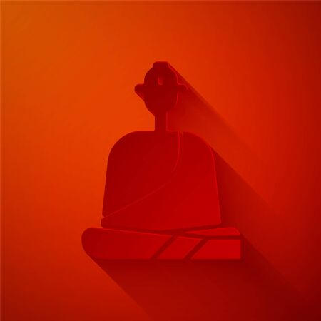 Paper cut Buddhist monk in robes sitting in meditation icon isolated on red background. Paper art style. Vector Illustration