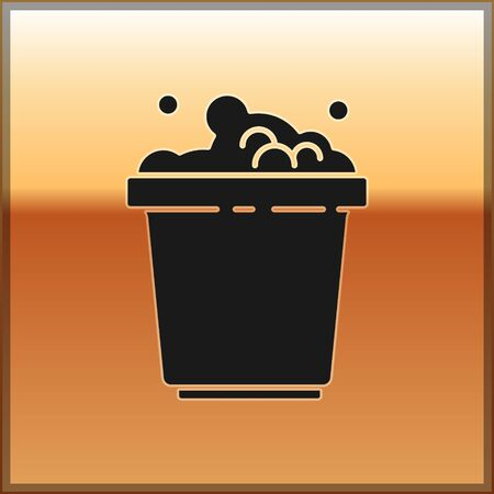 Black Bucket with soap suds icon isolated on gold background. Bowl with water. Washing clothes, cleaning equipment. Vector Illustration Ilustração