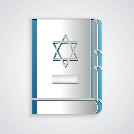 Paper cut Jewish torah book icon isolated on grey background. On the cover of the Bible is the image of the Star of David. Paper art style. Vector Illustration. Vettoriali