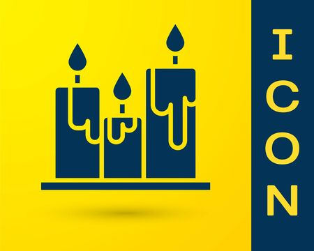 Blue Burning candles icon isolated on yellow background. Cylindrical candle stick with burning flame. Vector Illustration