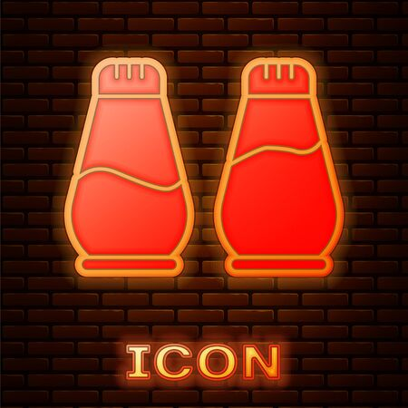 Glowing neon Salt and pepper icon isolated on brick wall background. Cooking spices. Vector Illustration.