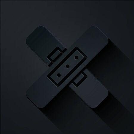 Paper cut Crossed bandage plaster icon isolated on black background. Medical plaster, adhesive bandage, flexible fabric bandage. Paper art style. Vector Illustration