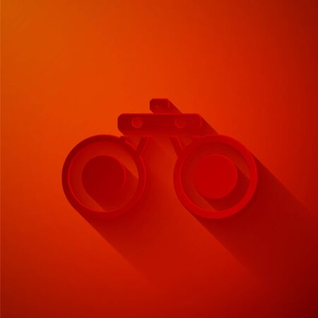 Paper cut Binoculars icon isolated on red background. Find software sign. Spy equipment symbol. Paper art style. Vector Ilustração