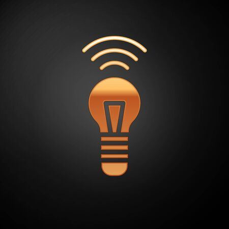 Gold Smart light bulb system icon isolated on black background. Energy and idea symbol. Internet of things concept with wireless connection. Vector