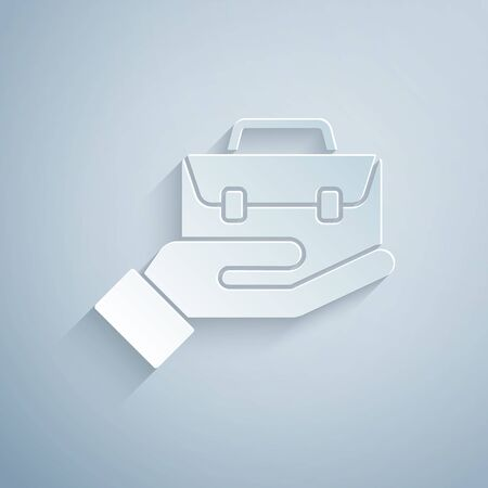 Paper cut Hand holding briefcase icon isolated on grey background. Insurance concept. Security, safety, protection, protect concept. Paper art style. Vector.
