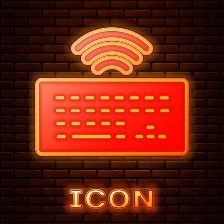 Glowing neon Wireless computer keyboard icon isolated on brick wall background. PC component sign. Internet of things concept with wireless connection. Vector